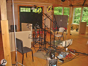 This picture gives an overview of the miking setup King used for The Goat Rodeo Sessions. Mandolinist Chris Thile was sat on the chair on the right, with violinist Stuart Duncan on the seat opposite him. Cellist Yo-Yo Ma was sat between the two low gobos next to Duncan, while Edgar Meyer played his upright bass standing between Ma and Duncan. The main left-centre-right mic rig of DPA 4006TL small-diaphragm omni mics is indicated in yellow.