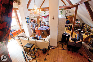 Don't waste the acoustic potential of the furniture around you — after all, it doesn't cost you anything! In this session, for instance, you can see that two guitar amps have been separated from the drums using a sofa and a mattress, while the kick–drum mic has also been baffled against cymbal spill using a couple of armchairs and a pile of blankets.