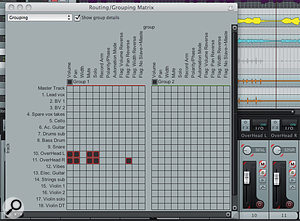 The Track Grouping Matrix displaying the first two groups. For the two drum-overhead tracks, volume, pan, mutes and solos are linked for convenience. 'Pan reverse' has been enabled for one of the two tracks so that the pan positions move in opposite directions when either of them is manipulated. The mixer view of the two tracks to the right-hand side of the image illustrates the coloured segments that appear to show that a specific control is associated with a group.