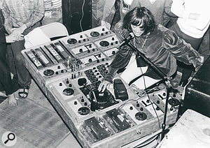 "Silver Apples live in Los Angeles, 1968. ""In this shot you can see I have the oscillators mounted horizontally in plywood along with echo units, wah pedal, and so on. Here I am playing the 'lead' oscillator with my right hand, keying in rhythm oscillators with my elbow on the telegraph keys, changing the volume on an amp with my left hand, and singing. This was typical."""