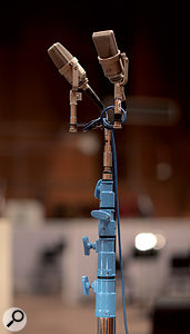 Unlike some long-established studios, the Sony scoring stage employs mainly modern high-end equipment rather than vintage gear. Here, apair of Neumann TLM170 mics sits atop aheavyweight stand.