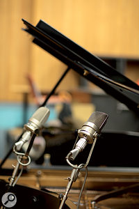 Inset, from left: two Neumann M49s capturing the grand piano in Studio 1; and just afew of Abbey Road's many vintage valve mic PSUs.