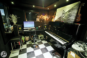 The main live area at Cabana Studio plays host to an upright piano, along with other assorted small instruments.