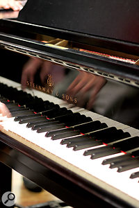 The beautiful Steinway grand piano used on the session was miked up using apair of Sennheiser MKH20 omni microphones, positioned close to the strings on aPiano Barre mounting system.