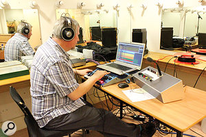 The recording was captured — and cue mixing performed — on Hugh's SADiE LRX system and Windows laptop, with monitoring in the control room taken care of by small PMC monitor speakers and AKG K702 headphones. The box on the right of the recording system is Hugh's custom-built talkback unit, which controlled the speaker, recording light and mic at the front of the hall. You can also see here in a little more detail, including the usefully narrow meters for every channel, the main SADiE screen setup used.