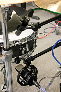 The initial plan for snare close-miking was to place an AKG C414 B-ULS on the bottom and aBeyerdynamic M201 on the top, with one polarity-inverted. It's acombination that often works, but it didn't seem to acquit itself so well on this piccolo, and in the end Matt was able to get afuller, more natural sound using apair of C414 B-ULS in the same configuration.