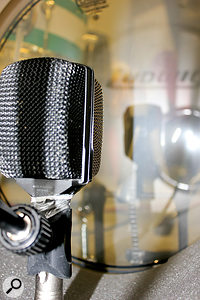 The kick sound came largely from the vintage AKG D12, placed inside the 16-inch kick near the batter head, with aCAD Equitek E200 in cardioid mode outside the drum for alittle extra definition.