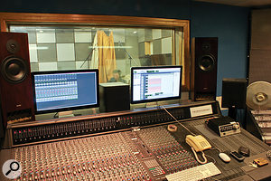 Matt's view over the Amek Angela console and through the glass to the live room. Note the configuration of Pro Tools, with the takes and waveforms on one screen and the mixer on another, which is a useful setup for this sort of tracking session.