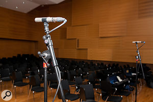 In addition to the main stereo pair and the five spot mics, Mike also erected a  wide-spaced stereo pair of small-diaphragm condenser mics out in the audience, pointing away from the stage, to capture additional room reverb, primarily as an optional stereo-width enhancement.