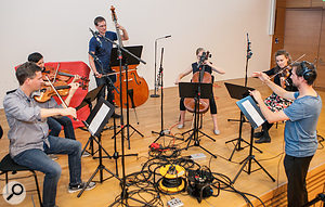 Without clear rhythmic events in the arrangement to which the performers could synchronise their playing, recording the layers in time with each other involved recording a  spoken guide track alongside the first take, and then conducting the ensemble while listening to that guide track over headphones.