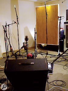 The room mics were a pair of Shure KSM141s in cardioid mode, and spaced to provide an extra-wide stereo image. The panel to the rear has been placed to direct a few more early reflections at these microphones. (A second panel is just out of shot to the left of the combo.)