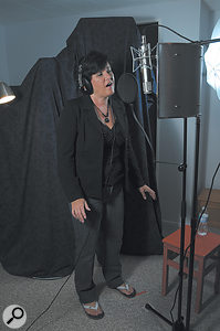 Kelly was set up with her mic and headphones in a  separate room adjacent to Thomas's control room.