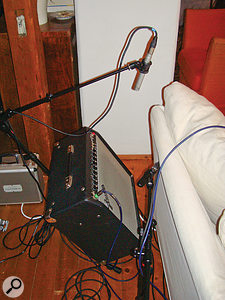 Here you can see how the two guitar amps were set up, tilted using K&M 28130 amp stands so that they were more audible to the guitarists playing them. Notice also the dual-miking setup, combining a more distant Samson C02 small-diaphragm condenser mic (supported via the amp stand's integrated boom arm) with a closer off-axis Shure SM57 dynamic.