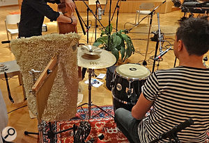 By gaffering a thick bathmat to a spare mic stand, Mike was able to use it to intercept excessive high frequencies from a bell tree before they reached the main stereo pair, thereby reducing the prominence of this instrument in the recorded ensemble balance.