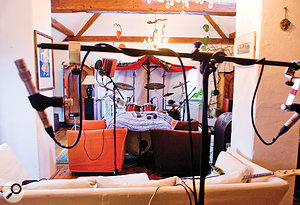 This picture was taken just before the recording of 'EnDance', from just behind the room mics. You can see the duvet/blanket tent I'd set up behind the drummer to close down the room sound, as well as the 'tunnel' I constructed to isolate the kick mic, using two armchairs and a bunch of blankets.