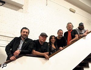 Heroically resisting the temptation to be photographed on azebra crossing, from left, guitarist Basel Hallek, guitarist and producer Tom Misner, singer Lyndsey Ollard, engineer Paul Pilseneks, bassist Murray Burns and drummer Mick Skelton line up on the stairs leading up to the Studio Two control room.