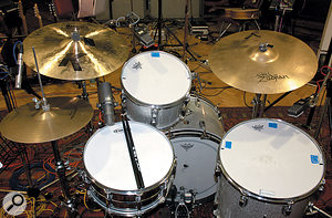 The drum close-miking arrangement was fairly conventional, with AKG C414s on toms, Shure SM7 on snare and Neumann KM84s spot miking the hi-hat and ride (not visible).