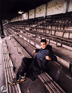 Robbie Williams blends into the crowd at a  Stoke City home match.
