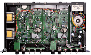 The Fox's internal construction is to very high standards, with the linear power supply isolated behind a metal screen to the right, and the output transformers mounted on the left-hand side wall. The three small socketed ICs on each channel's circuit board are OPA2604 op-amps, while the two large ICs are logic control chips for the relays.