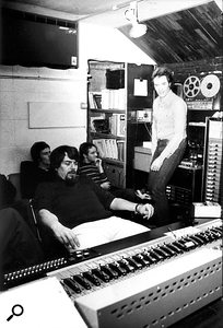 John Wood and Pat Donaldson (standing) with singer–songwriter Allan Taylor (rear left) and drummer Dave Mattacks in the Sound Techniques control room.