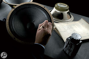 A completed speaker receives its edge treatment.