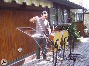 One of Diego Stocco's mad contraptions: this one made out of a drying rack and two acoustic guitars and played with a cello bow.