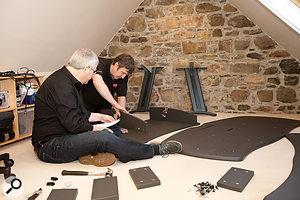 With the wooden units that Ian was using as adesk moved out of the way, Hugh and Paul set about assembling the AKA Designs ProMedia studio desk.