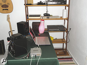 The setup, including the speakers, was initially arranged so that it was facing the wall, which was bouncing sound back towards the monitoring position