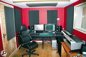 To minimise problems with bass in small and medium-sized rooms, make sure your speakers aim down the length of the room, pointing towards the listener's ears. In this picture, you can also see the 'mirror‑point' acoustic treatment that is used to absorb mid-range and high frequencies, resulting in better stereo imaging.