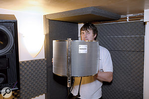 In the corner where most of the vocal recording takes place, Paul White glued some foam to the wall and ceiling, adding to what was already stuck to the door, to kill off as much room sound as possible.