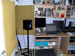 Joe bought some speaker stands to elevate his Alesis monitors to the correct level, and hung some spare furniture foam on the walls to tame the early reflections.