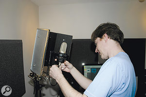 An SE Reflexion Filter was fitted to the mic stand, to reduce the amount of room reflection reaching the microphone.