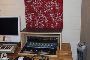 The stands were placed over the rack units, with ceramic tiles resting on top to provide extra mass.
