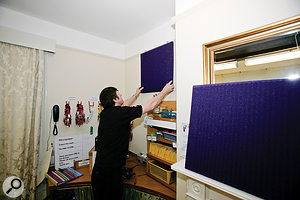 Some Universal Acoustics foam hung on the walls and against the mirror, along with aduvet on the opposite wall, yielded asignificant reduction in room coloration on subsequent test recordings.