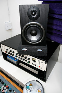 The monitors were placed on some Universal Acoustics isolators, and the whole monitoring system's gain structure was adjusted so that the monitor controller in the mixer provided more accurate left/right level tracking.