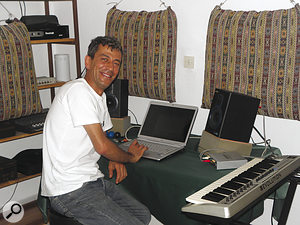 Emrah at his new mix position. With the setup reoriented so that the speakers were firing into the room, the speakers placed on some makeshift supports, and cushions strategically hung on the walls, the monitoring became significantly more accurate.