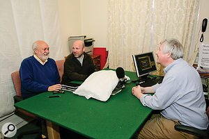 John Richards (left), Simon Applebaum (centre) and Hugh Robjohns (right) trying out the new recording setup. The microphone distance had been significantly reduced, and a pillow placed between the mics to further minimise room coloration.