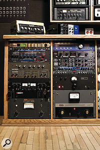 "The outboard racks at Soma are stuffed to the gills with unusual gear. In the wall‑mounted rack at the top are visible a Roland Space Echo and Multivox Multi Echo. A Binson Echorec and API Lunchbox sit atop the lower rack, which houses (left rack, top to bottom) TC Electronic M3000 multi‑effects, Lexicon PCM60, Ursa Major Space Station and Sound Workshop reverbs, Thermionic Culture Culture Vulture distortion unit, Roland Dimension D spatial enhancer and ITA LA1B compressor (""similar to an LA2A""); (right rack) Eventide H3000S and H910 Harmonizers, Marshall Time Modulator flangers (x2), Lexicon PCM42 delay, BSS DPR502 noise gate, and Federal and Gates compressors. ""In extreme settings, the Gates is really good on drums. When you push it really hard, you get this really interesting kind of rubbery distortion."""