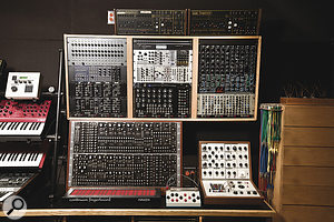 Tortoise's impressive modular setup is based around a CMS system (in the large rack, lower left), augmented with two ARP sequencers (top) and sundry FracRac and other modules. Also shown is the band's EMS VCS3.
