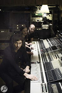 Kalle Gustafsson Jerneholm, Henrik Gustafsson and Hans Olsson Brookes sitting at Svenska Grammofon's legendary Neve 8048 mixing console. It was once installed at the Montreux Casino, as name‑checked in Deep Purple's 'Smoke On The Water'.
