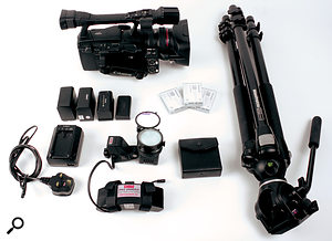 Here's a Canon XH A1 HDV camcorder with a basic shooting kit. There are four batteries in this shot. The larger ones last longer but are heavier, and the charger is included just in case! Towards the bottom is a DSM light that mounts on the front of the camera, and a battery pack for the light, which attaches to the hand strap. Three Panasonic DV tapes are shown, along with a box for various filters (more on which in a later issue). Finally, a Manfrotto tripod provides solid support and the ability to pan smoothly, something that's hard to achieve when using tripods designed for still photography.