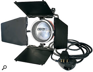 This tungsten 'redhead' light is equipped with 'barn doors' for controlling the light beam. Fresnel lights also have a focusing lens over the lamp.