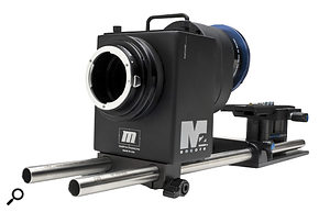 In order to achieve film‑like shallow depth of field, Adam attached aRedrock M2 to the DVX100's fixed lens, and Nikon lenses to the front of this. The camera records the image projected onto a spinning piece of glass.