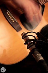 Placing the mic somewhere in an arc around the bridge, and pointing roughly towards it offers an alternative single‑mic position that places less emphasis on the bright string sound than the 'vanilla position'.