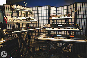 Ari Levine's keyboard racks contain mainly modern digital synths. In the left one, from top: MicroKorg, Alesis Ion and Roland V‑Synth; (right) Korg R3, Roland V‑Synth GT and Fantom 88R. To the left is an Access Virus desktop synth.