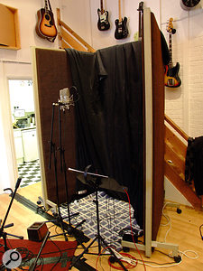 The vocal booth is usually home to a  Neumann M149.