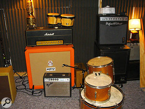 A selection of guitar and bass amps, including the Fender Vibro Champ reissue and Marshall Plexi / Orange cab combination used by Ben Allen on the Gnarls Barkley album.