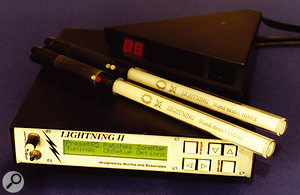 The Lightning II motion-to-MIDI converter, with two of its wand controllers.