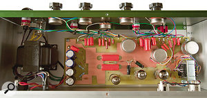 Internal view of the Cartec EQ showing the three transformers, one tapped inductor and the three valves, all mounted on afibre‑glass 'circuit board' — albeit arather unconventional one.