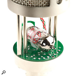 The ECC83 dual triode tube, used in both mics, is fitted to a ceramic base, with the tube fixed horizontally across the circuit board.